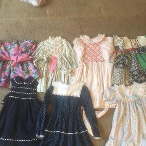 Vintage girls clothing ranging in size.